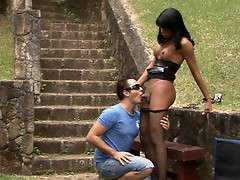 Drop dead gorgeous shemale in sheer black pantyhose screwing an eager guy