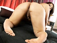 Lovely tgirl Gia posing and playing with herself