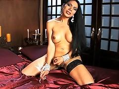 Brunette hottie Melissa masturbating on the bed
