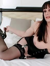 Busty tgirl Tiffany Taylor posing in a sexy corset