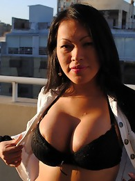Big titted Teresa teasing on the balcony