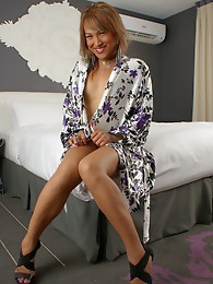 Beautiful transsexual Myah posing on the bed