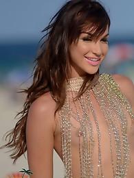 Adorable tgirl Jonelle posing on the beach