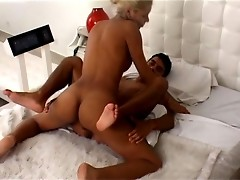 Sultry blonde t-girl in golden bikini fucking and getting fucked for a load