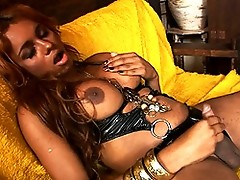 Sweet chocolate transsexual playing with her ass and cock