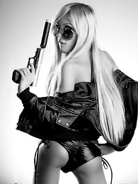 Super hot Kimber James posing with a gun in black & white
