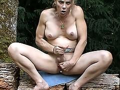 Horny TMILF Jasmine Jewels pleasuring herself in the woods