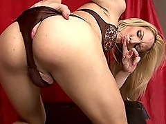Horny blonde Laviny stripping and jerking off her huge cock