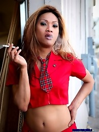 This ladyboy in red is really smokin!