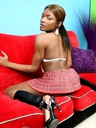 Ebony goddess Amyiaa posing as a naughty schoolgirl