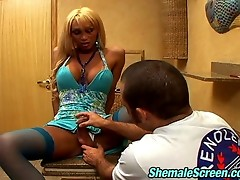 Blonde shemale in blue stockings fucking and getting fucked on the table