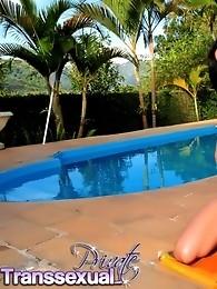 Brunette tgirl hottie Luana posing by the pool