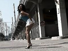 Naughty Vaniity posing in a sexy miniskirt